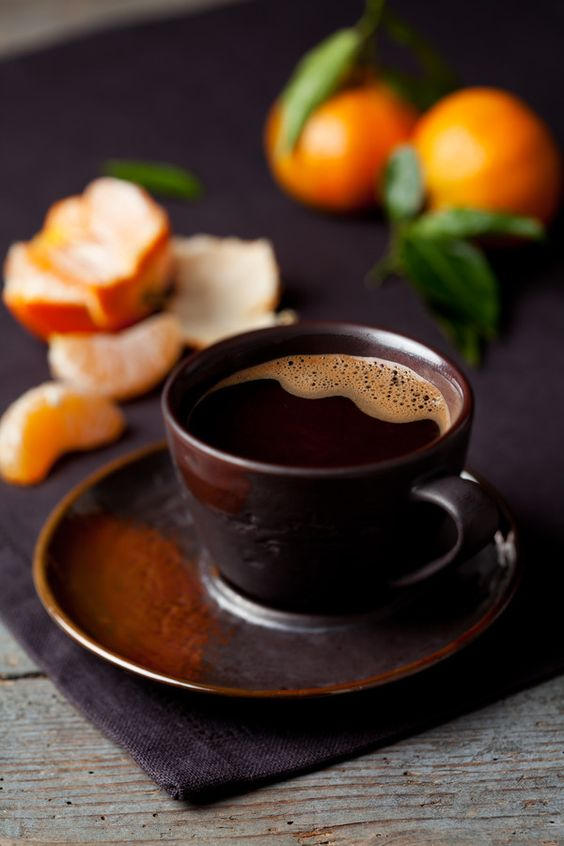 Cup of coffee and clementines